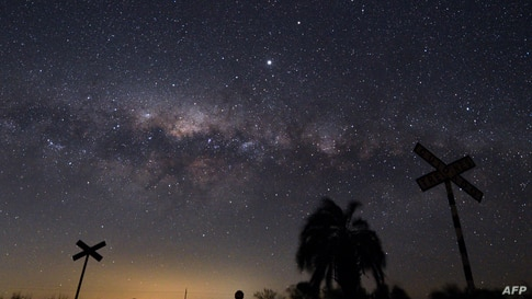 The Milky Way's Galactic Centre and Jupiter (brightest spot at centre top) are seen from the countryside near the small town of…