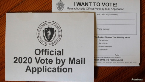 """An """"Official 2020 Vote by Mail Application"""" for the state of Massachusetts is displayed in a photo illustration."""