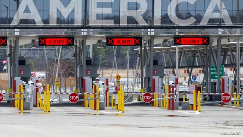 FILE PHOTO: The U.S.-Canada border crossing is seen amid the coronavirus disease (COVID-19) outbreak in Lacolle, Quebec, Canada…