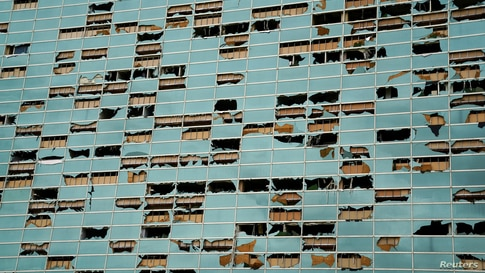 The facade of a building is seen damaged after Hurricane Laura passed through Lake Charles, Louisiana, U.S. August 27, 2020…