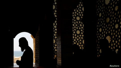 Palestinian members of the staff pray in an almost empty mosque as Friday prayers in the holy places are suspended following…