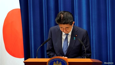 Japanese Prime Minister Shinzo Abe bows during a news conference at the prime minister's official residence in Tokyo, Japan,…