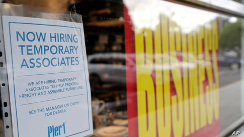 A sign advertises hiring of temporary associates at a Pier 1 retail store, which is going out of business