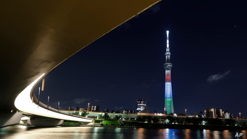 The Tokyo Skytree shows a special lighting in red, blue and green, the symbol colors of the Tokyo 2020 Paralympic Games, in…