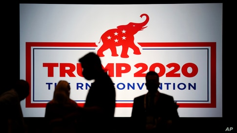 The room is set and delegates begin to arrive for the first day of the Republican National Convention, Monday, Aug. 24, 2020,…