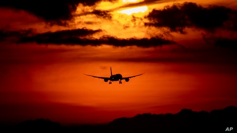 An aircraft approaches the airport in Frankfurt, Germany, as the sun rises on Thursday, Aug. 27, 2020. With more and more…