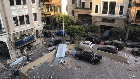 Debris from Beirut explosion is seen on the street from VOA reporter Anchal Vohra's apartment window in Beirut, Lebanon, Aug. 4, 2020. (Photo: Anchal Vohra / VOA)