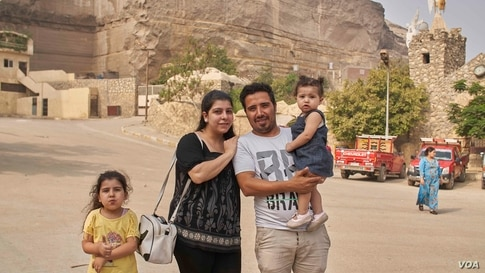 """""""We are worried that the virus will start spreading faster but we don't ever want to stop praying or going to church,"""" said Mosa Nazmy after the church service attending a mass with his wife and children, Aug. 30, 2020 in Cairo. (Hamada Elrasam/VOA)"""