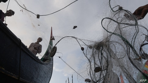 Fishermen prepare their nets after fishing in the sea in Shamlapur, some 50 km from Cox's Bazar, Bangladesh.