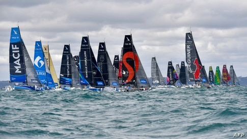 Sail boats take the start of the 51st edition of La Solitaire du Figaro solo sailing race off the coast of Saint-Quay-Portrieux, in Saint-Brieuc Bay, northwestern France, in the first stage of the race.