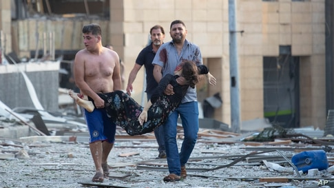 A wounded person is evacuated after a massive explosion in Beirut, Lebanon, Aug. 4, 2020.