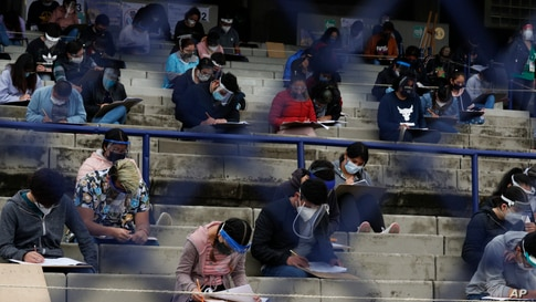 Students take an entrance exam for Mexico's National Autonomous University, amid the ongoing coronavirus pandemic at the University Olympic Stadium in Mexico City.