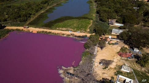 A road divides the Cerro Lagoon and the Waltrading S.A. tannery, bottom right, in Limpio, Paraguay, Aug. 5, 2020.