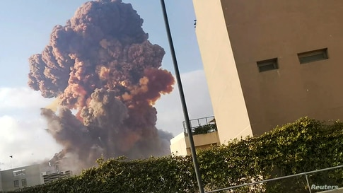 Smoke rises after an explosion in Beirut, Lebanon, Aug. 4, 2020, in this picture obtained from a social media video. (Karim Sokhn/Instagram/Ksokhn + Thebikekitchenbeirut/via Reuters)