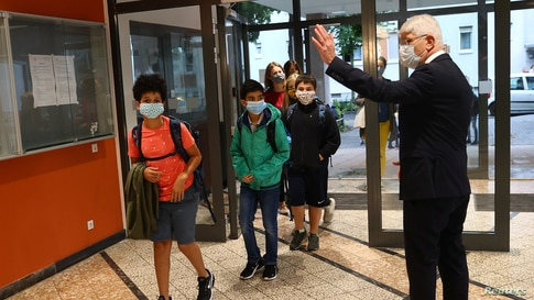 Director Juergen Scheuermann welcomes students as schools re-open after summer holidays and the lockdown due to the outbreak of the coronavirus disease (COVID-19) at the Karl-Rehbein high school in Hanau, Germany.