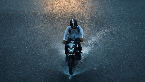 A man rides a motorbike during heavy rains in New Delhi, India.