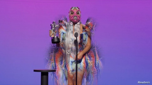 """Lady Gaga accepts the award for Best Collaboration for """"Rain On Me"""" during the 2020 MTV VMAs in this screen grab image made available on Aug. 30, 2020."""