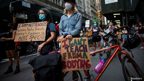 People take part in a march during the National Day of Resistance to schools re-opening amid the outbreak of COVID-19 in New York City, Aug. 3, 2020.