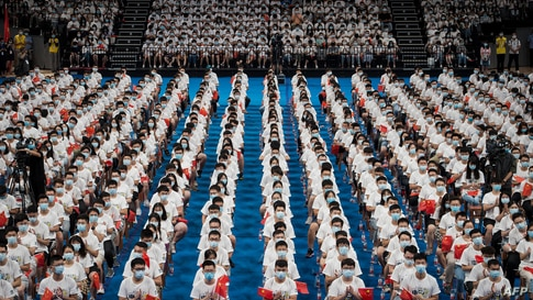 Students at the Huazhong University of Science and Technology attend a commencement ceremony in a gymnasium in Wuhan, in China…