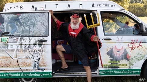 Cycling fan Didi Senft, aka El Diablo, waits for the riders during the 7th stage of the 107th edition of the Tour de France…