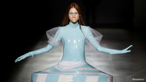 A model presents a creation by graduates of the Open Fashion Studio clothing design school during Ukrainian Fashion Week in…