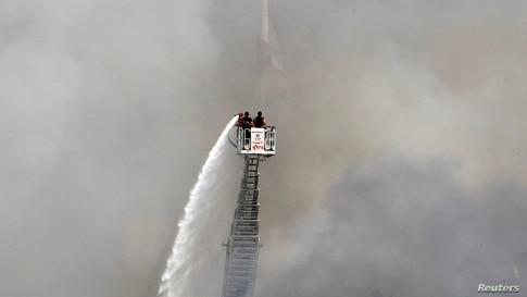 A man uses a water hose to put out the remains of a fire that broke out at Beirut's port yesterday, Lebanon September 11, 2020…