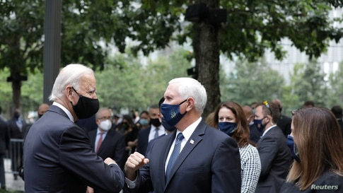 Democratic presidential candidate and former U.S. Vice President Joe Biden and Vice President Mike Pence greet each other…