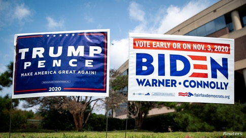 FILE PHOTO: Yard signs supporting U.S. President Donald Trump and Democratic U.S. presidential nominee and former Vice…