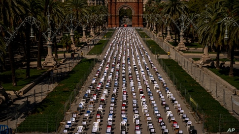 Empty chairs with the names of activists are seen placed on a boulevard with the triumphal arch at the background, during a…
