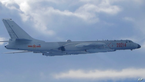In this photo released by the Taiwan Ministry of National Defense, a Chinese People's Liberation Army H-6 bomber is seen flying…