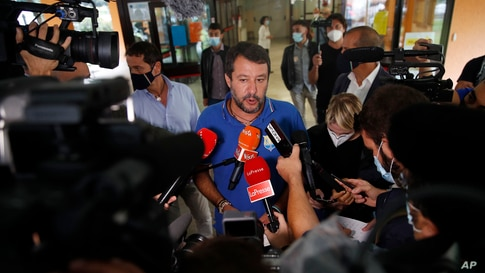 Right-wing opposition leader Matteo Salvini leaves a polling station, in Milan, Italy, Sept. 21, 2020.
