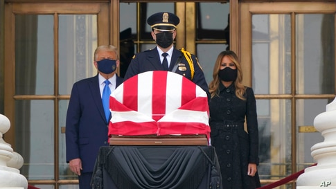 President Donald Trump and first lady Melania Trump pay respects as Justice Ruth Bader Ginsburg lies in repose at the Supreme Court building, Sept. 24, 2020, in Washington.