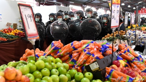 Riot police clear Melbourne's Queen Victoria Market of anti-lockdown protesters during a rally on amid the COVID-19 pandemic.