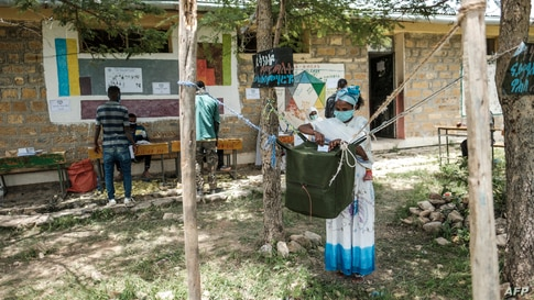 A woman casts her ballot at a polling station during Tigray's regional elections, in the town of Tikul, 15 kms east from Mekele, Ethiopia, Sept. 9, 2020.