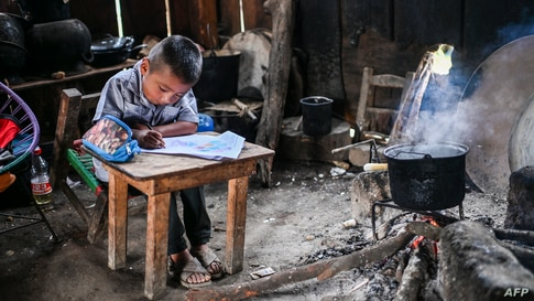 A boy the Santiago family is homeschooled in San Miguel Amoltepec Viejo, Guerrero state, Mexico, amid the COVID-19 pandemic.