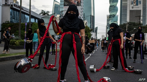 A group of women perform during a protest against the alleged corruption and the lack of measures with a gender perspective, in Panama City, Panama, Sept. 02, 2020.