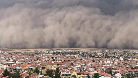 A handout TV grab made available by the Demiroren News Agency (DHA) shows a freak sandstorm sweeping over Polatli, in Ankara,Turkey, Sept. 12, 2020.