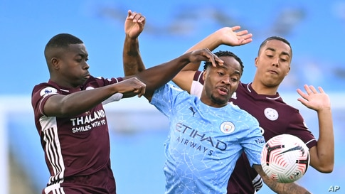 Leicester's Nampalys Mendy (l) vies for the ball with Manchester City's Raheem Sterling, center, and Leicester's Youri Tielemans during the English Premier League soccer match between Manchester City and Leicester City at the Etihad stadium in Manchester, England.