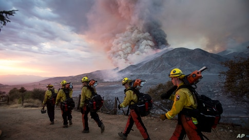 Firefighters walk in line during a wildfire in Yucaipa, California.
