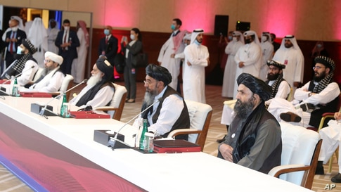 The Taliban delegation attends the opening session of peace talks between the Afghan government and the Taliban, in Doha, Qatar, Sept. 12, 2020.