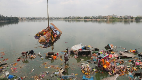 Workers remove idols of elephant-headed Hindu god Ganesha that were immersed in Saroornagar Lake on the final day of Ganesh Chaturthi festival in Hyderabad, India.