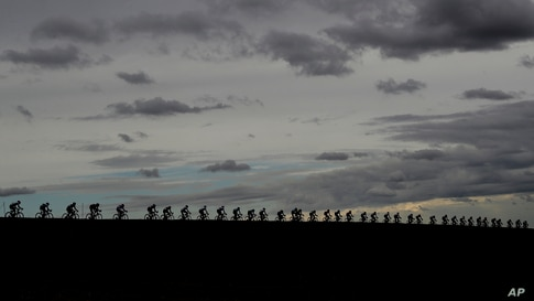 Riders pedal under a cloudy sky in the Men's Elite eventin Imola, Italy, during the the UCI 2020 Road World Championships.