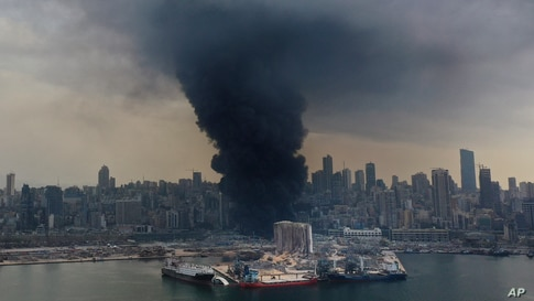 Black smoke rises from a fire at warehouses at the seaport of Beirut, Lebanon.