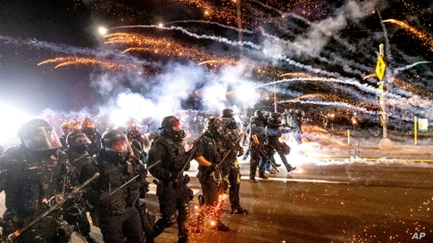 Police use chemical irritants and crowd control munitions to disperse protesters during a demonstration in Portland, Oregon, Sept. 5, 2020.