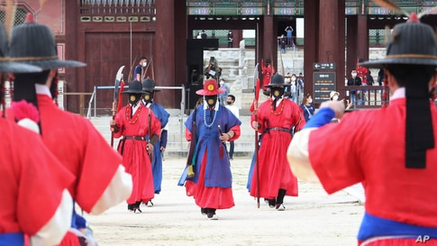 Imperial guards wearing face masks are seen outside the Gyeongbok Palace in Seoul, South Korea.