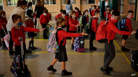Students wait in a queue before entering a classroom, at the Luis Amigo school, in Pamplona, northern Spain, Sept. 7, 2020.
