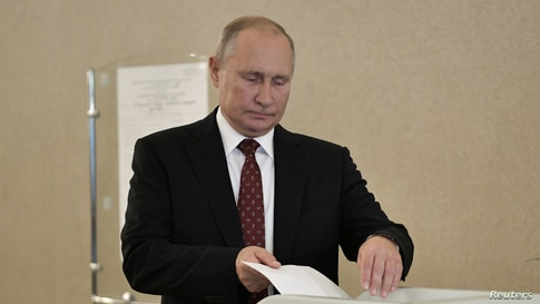 FILE - Russian President Vladimir Putin casts his ballot at a polling station during the Moscow city parliament election in Moscow, Russia, Sept. 8, 2019. (Sputnik/Alexei Nikolsky/Kremlin via Reuters)