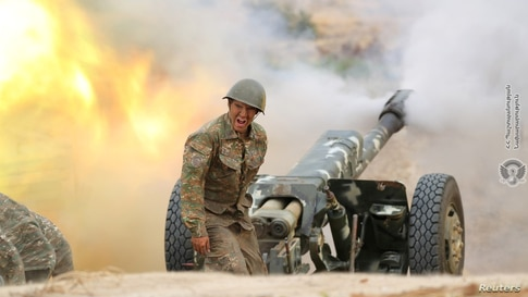 An ethnic Armenian soldier fires an artillery piece during fighting with Azerbaijan's forces in the breakaway region of Nagorno-Karabakh.