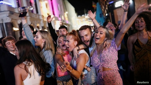 People sing and dance in Leicester Square amid the coronavirus disease (COVID-19) outbreak in London, Sept. 12, 2020.
