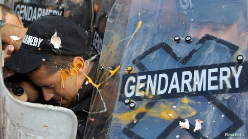 A police officer is thrown by an egg during a scuffle with protesters during an anti-government demonstration in Sofia, Bulgaria.